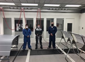 John Beauregard from PPG Industries, Jason Couillard from SATA Canada, and Fix Network technical trainer Amir Farrokh, complete paint tests.